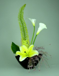 yellow and white callas in black vase